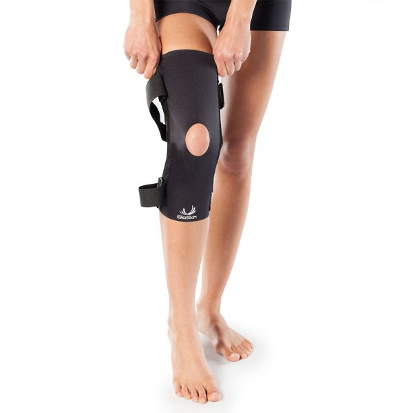 Knee brace for patella tilt and glide problems