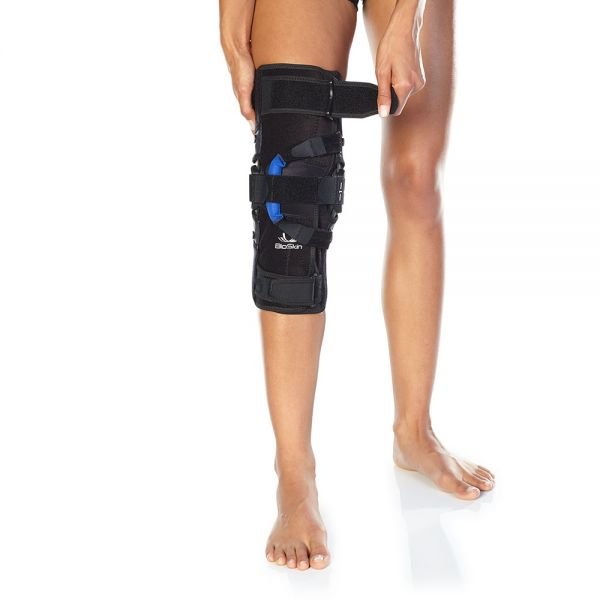Hinged knee brace for kneecap support